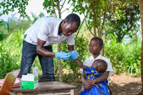 Photo: Health worker, boy, sibling